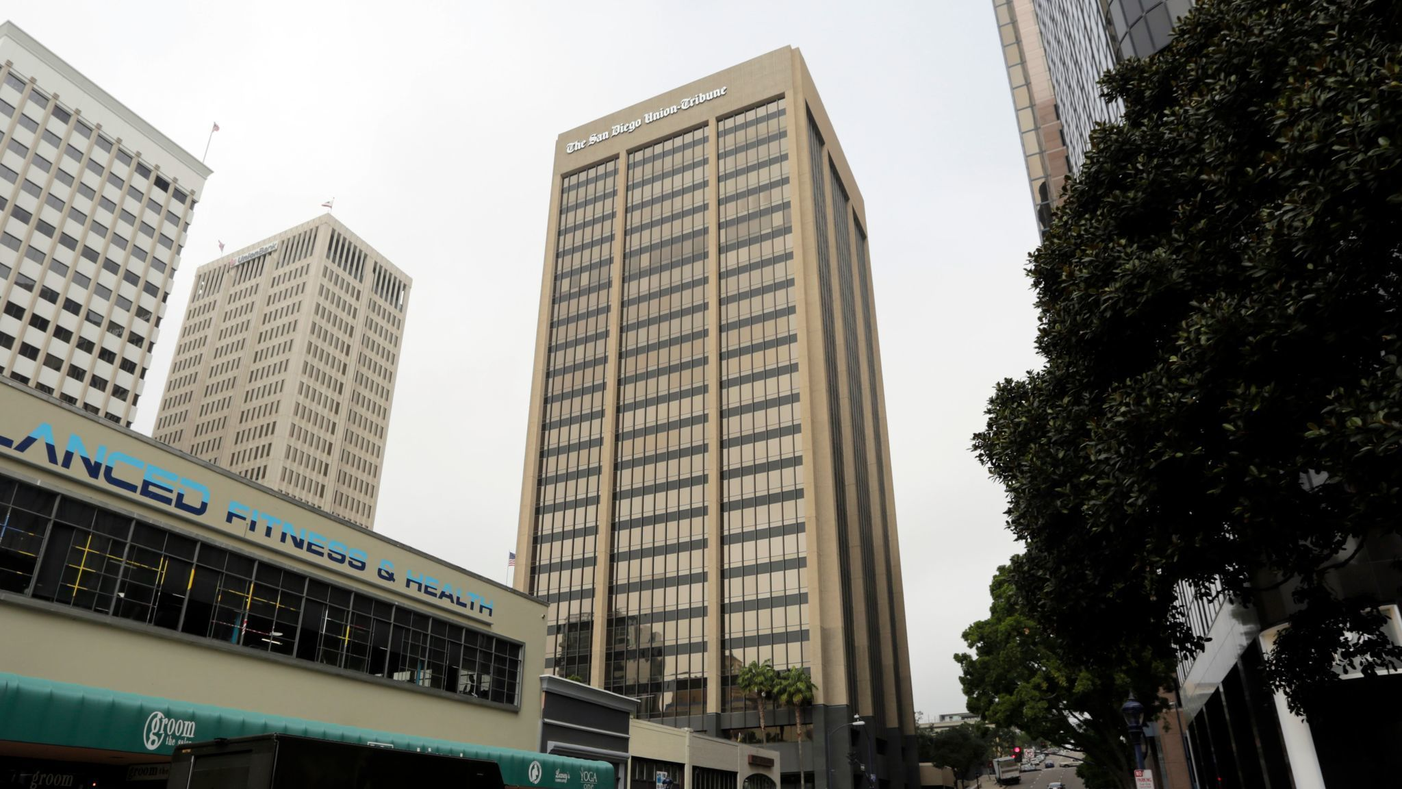 Two downtown highrises sell for $167M. Declining vacancies equal rising prices.